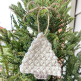 crochet christmas tree ornament hung with twine