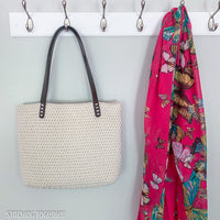 crochet bag hanging next to a bright scarf