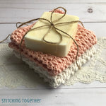 2 crochet washcloths and a bar of soap tied with twine