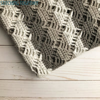 close up of diamond lace crochet baby blanket