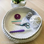 crochet bowl with crochet hooks and scissors
