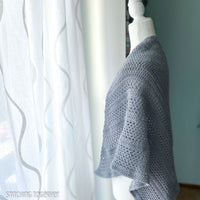 gray crochet shawl on mannequin