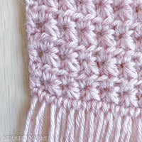 close up of fringe and crochet scarf stitches