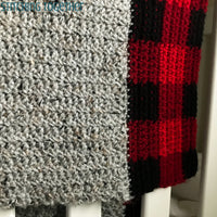 crochet buffalo plaid border on gray baby blanket