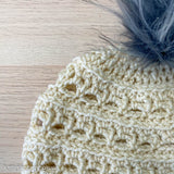 close up of crochet stitches on a womens beanie