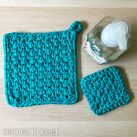 crochet potholders with a bottle of soap