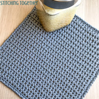 gray crochet washcloth pictured with body wash