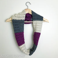 striped crochet infinity scarf on a hanger