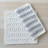 textured crochet dishcloths one folded on top of the other