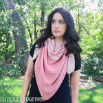 woman wearing crochet triangle shawl