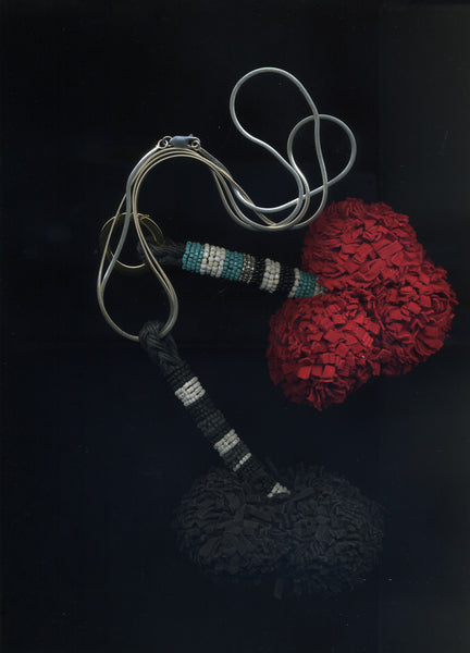 Leather Pom Pom Necklaces - £188
