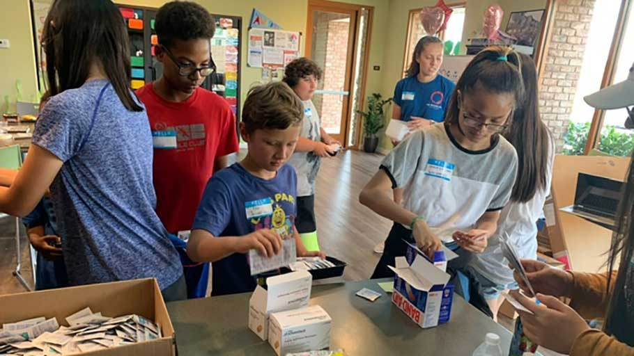 Resident kids in Jamboree's free onsite summer learning program make first aid kits