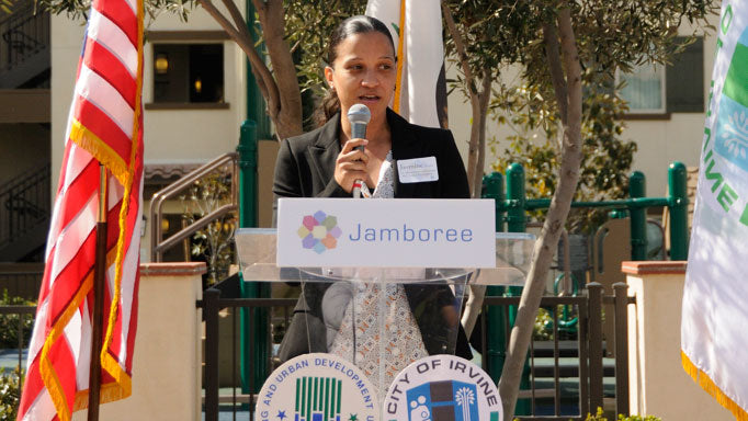 HUD speaker at affordable community Doria Apartment Homes in Irvine grand opening.