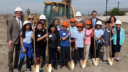 Jamboree, and children from nearby school at Clark Commons ground breaking in Buena Park, CA