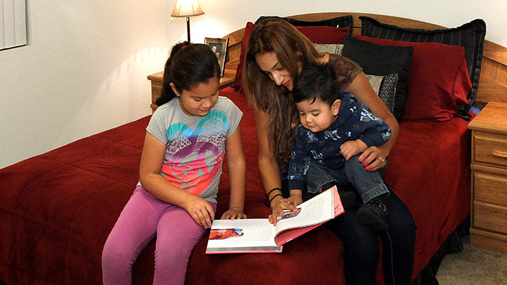 Jamboree residents reading together at Birch Hills in Brea