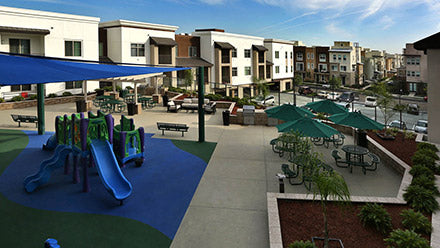 Residents enjoy tot lot and playground at Jamboree's Clark Commons Community Collaborative affordable housing