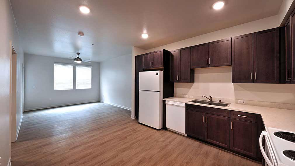 •	Jamboree's Compass Rose affordable housing unit kitchen, living room