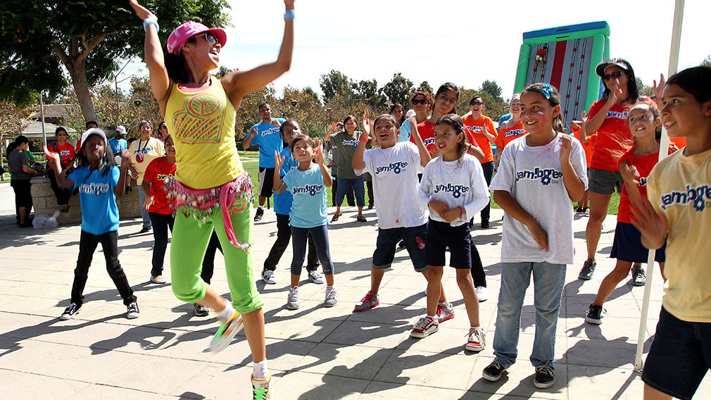 Zumba instructor at Jamboree Day encouraging health and fitness.