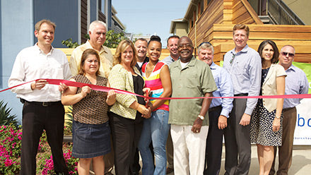 Marcy Finamore, staff, partners and residents at the Collage ribbon cutting in Long Beach