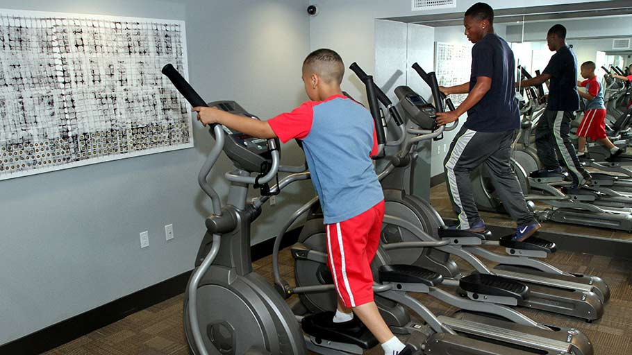 Jamboree's ParkLanding residents exercise in fitness center Buena Park