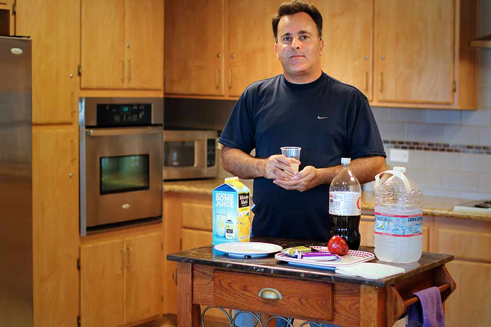 Resident using kitchen at Diamond, a supportive housing community