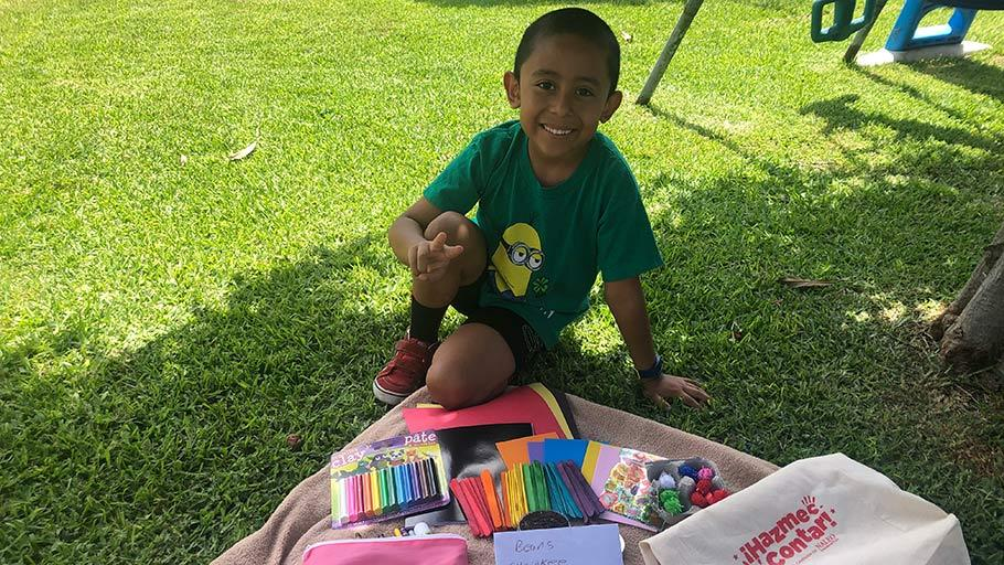 Jamboree resident smiling at his summer learning activity kit