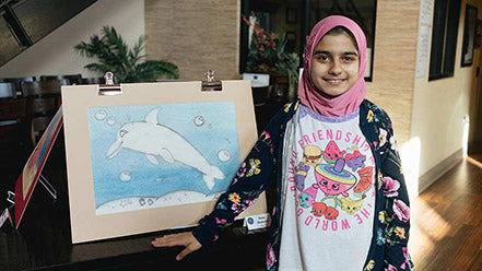 Jamboree resident proudly shows off her artwork