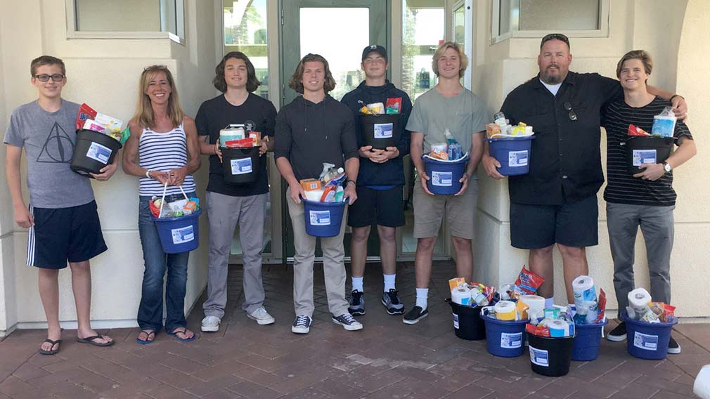 This group of volunteers donated time and passed out cleaning supplies at Doria in Irvine.