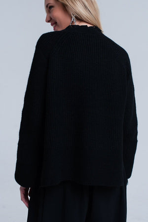 Black knitted sweater with open side detail