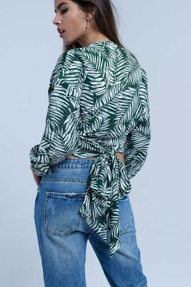 Green leaf print blouse with plunge neck