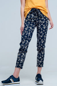 Q2 Navy floral pants with a belt