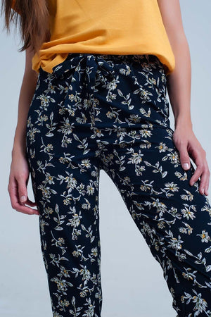 Navy floral pants with a belt