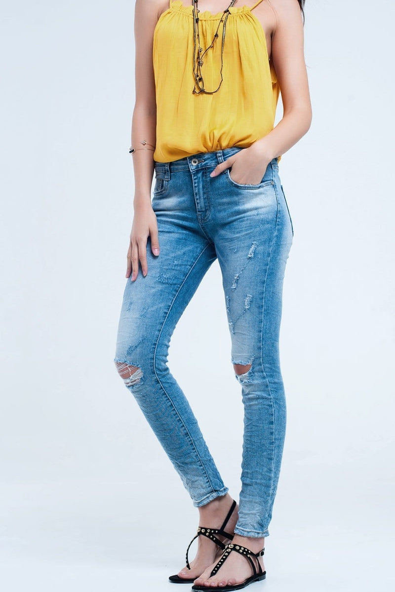 Q2 Skinny jeans in mid wash with knee rips