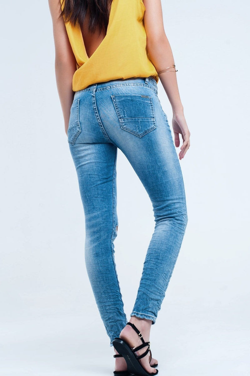 Skinny jeans in mid wash with knee rips - Himelhoch's