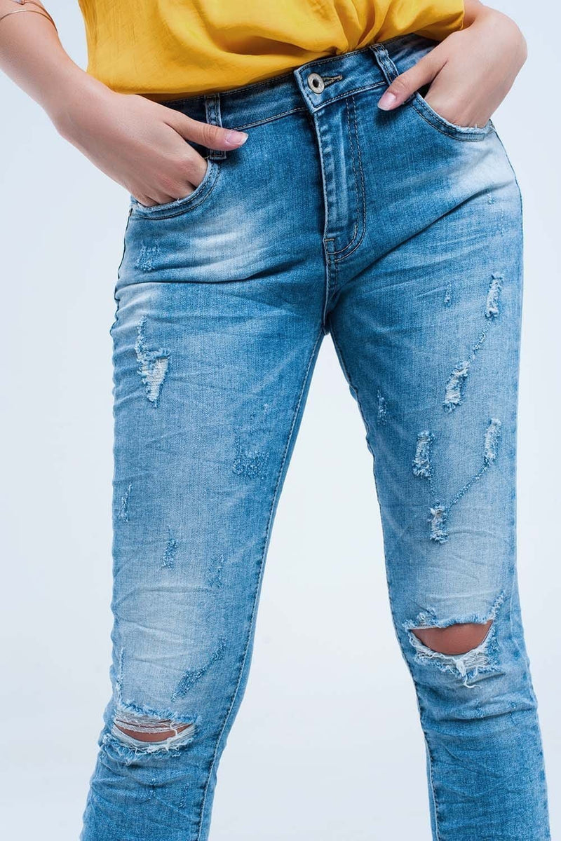 Skinny jeans in mid wash with knee rips