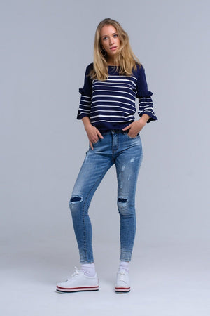 Q2 Skinny jeans with rips