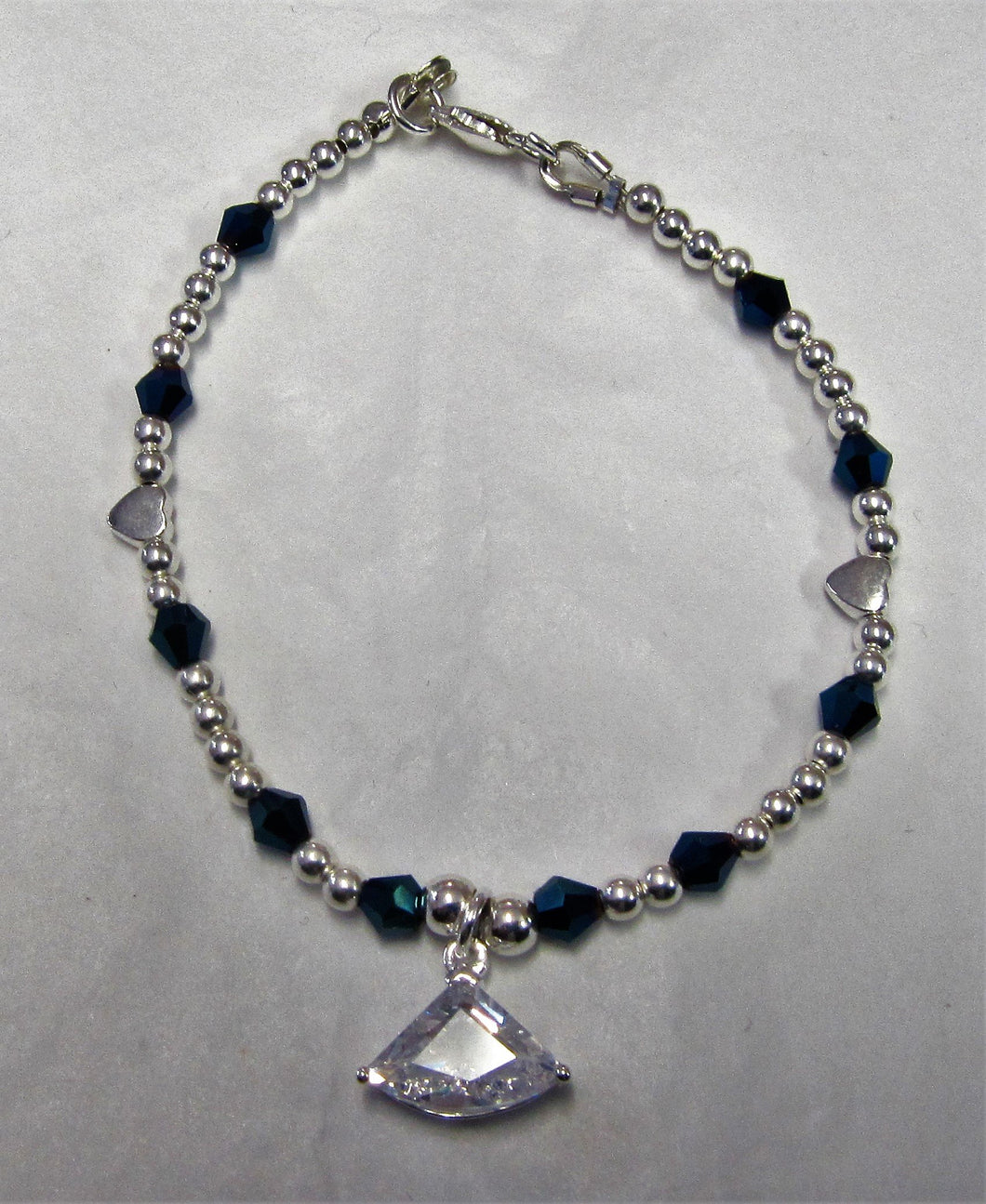 Beautiful handcrafted sterling silver bracelet with swarovski crystal and cubic zirconia drop