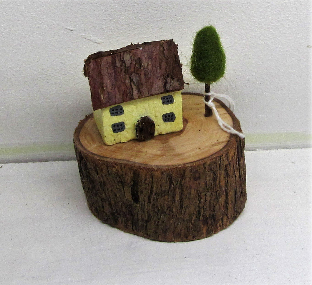 Beautiful handcrafted wooden log houses in various colours
