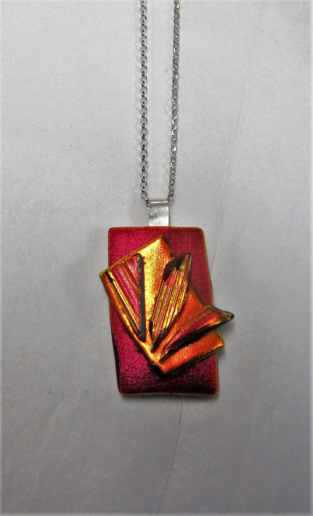 Beautiful handcrafted dichroic glass pendant on a sterling silver necklace