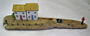 Beautiful handcrafted driftwood two cottage with  boat