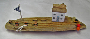 Beautiful handcrafted driftwood harbour side cottage with flag