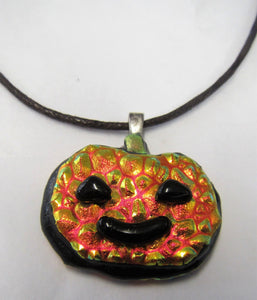Beautiful handcrafted orange pumpkin pendant on leather necklace