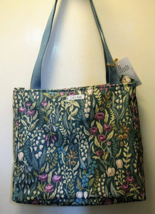 Beautiful handcrafted teal floral wax fabric handbag with two blue handles