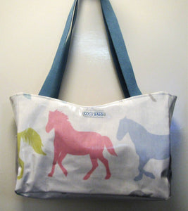 Beautiful handcrafted horse wax fabric handbag with blue handles