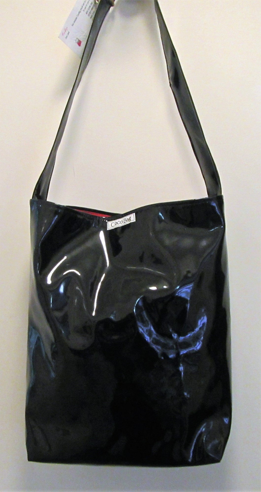Beautiful handcrafted black patent handbag with one handle
