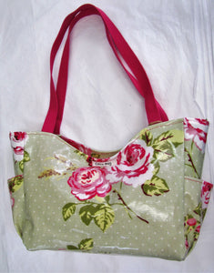 Beautiful handcrafted Pink and green floral wax fabric handbag with two pink handles