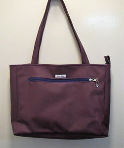 Beautiful handcrafted faux leather purple handbag