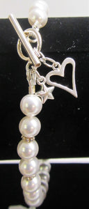 Beautiful handcrafted bracelet with swarovski pearls and silver heart and star