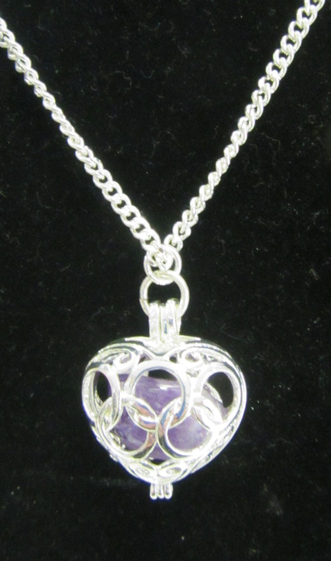 Beautiful handcrafted silver plated necklace with amethyst stone enclosed in the heart