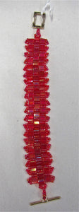 Beautiful handcrafted bracelet with red beads, fastened with a magnetic clasp